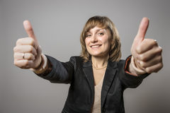 Young business woman with two thumbs held high royalty free stock photos