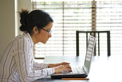 Young Business Woman Typing on Laptop Stock Images