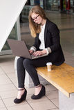 Young business woman typing on a laptop Stock Images