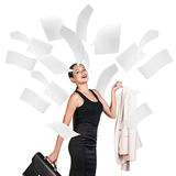 Young business woman under falling pages. stock images