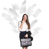 Young business woman under falling pages. stock photo