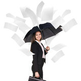 Young business woman under falling pages. royalty free stock image