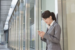 Young business woman use cellphone Stock Images