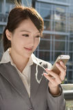 Young business woman use cellphone Royalty Free Stock Images