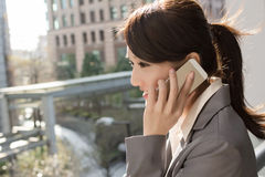 Young business woman use cellphone Royalty Free Stock Photography