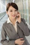 Young business woman use cellphone Stock Image