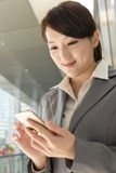Young business woman use cellphone Royalty Free Stock Photo
