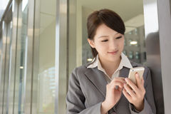 Young business woman use cellphone Stock Photography
