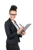 Young business woman uses a clipboard Royalty Free Stock Image