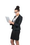 Young business woman uses a tablet Royalty Free Stock Photography