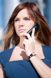 Young business woman using cell phone Stock Photo
