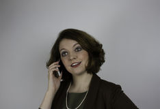Young business woman using cell phone Stock Image
