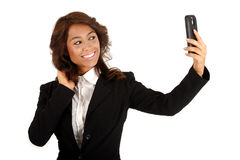 Young business woman using a cellphone to take a selfie photograph. Royalty Free Stock Photos