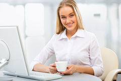 Young business woman using computer at office Royalty Free Stock Photo