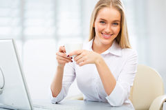 Young business woman using computer at office Royalty Free Stock Image