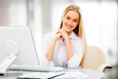 Young business woman using computer at office Stock Images