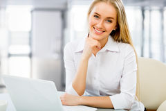 Young business woman using computer at office Stock Image