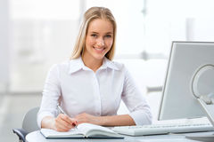 Young business woman using computer at office Stock Photos