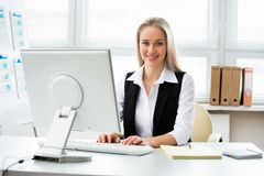 Young business woman using computer at office royalty free stock photography