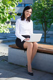 Young business woman using laptop in city park Royalty Free Stock Photo