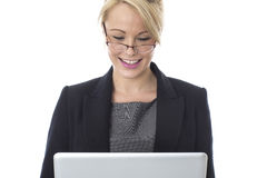 Young Business Woman Using a Laptop Computer Royalty Free Stock Photos
