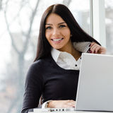 Young business woman using laptop PC at office Royalty Free Stock Photography