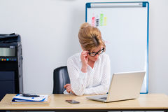 Young business woman using laptop Stock Photo