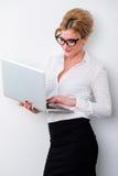 Young business woman using laptop Stock Photos