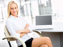 Young business woman using laptop Stock Photos