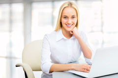 Young business woman using laptop Stock Image