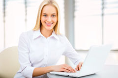 Young business woman using laptop Stock Images