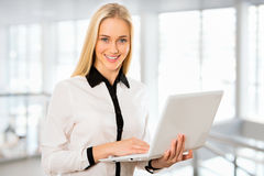 Young business woman using laptop Royalty Free Stock Photo