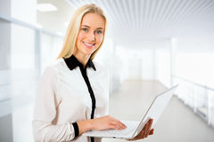 Young business woman using laptop Stock Photography