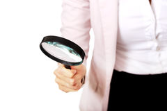 Young business woman using a magnifying glass Stock Photography