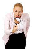 Young business woman using a magnifying glass Stock Image