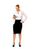 Young business woman using a mobile phone Royalty Free Stock Photo