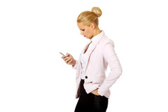Young business woman using a mobile phone Stock Image