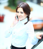 Young business woman using mobile phone Stock Photo
