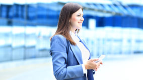 Young business woman using mobile phone Royalty Free Stock Photos