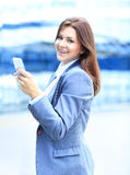 Young business woman using mobile phone Royalty Free Stock Images