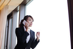 Young business woman using smart phone. Young business travel woman using smart phone in her hotel room, asian Stock Photo