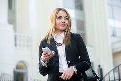 Young business woman using smartphone Stock Photo
