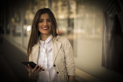 Young business woman using tablet in the city Stock Photo
