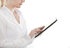 Young business woman using a tablet computer. Young attractive business woman uses a mobile tablet computer with touch screen Royalty Free Stock Photography