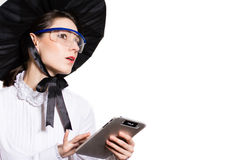 Young business woman using tablet PC and wearing glasses and futuristic hat Stock Photos
