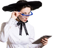Young business woman using tablet PC and wearing glasses and futuristic hat Royalty Free Stock Photography