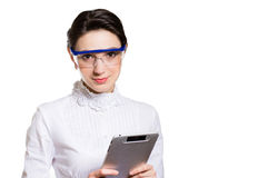 Young business woman using tablet PC and wearing glasses Royalty Free Stock Image