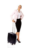 Young business woman waiting for travel with suitcase Royalty Free Stock Images
