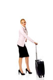 Young business woman waiting for travel with suitcase Royalty Free Stock Photography