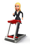 Young Business Woman with walking machine Stock Images